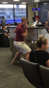 Man ROCKS OUT on PA at the Airport